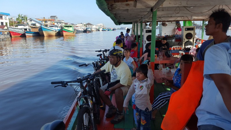 Participants Sunday Bike Pontianak on a boats on the kapuas river